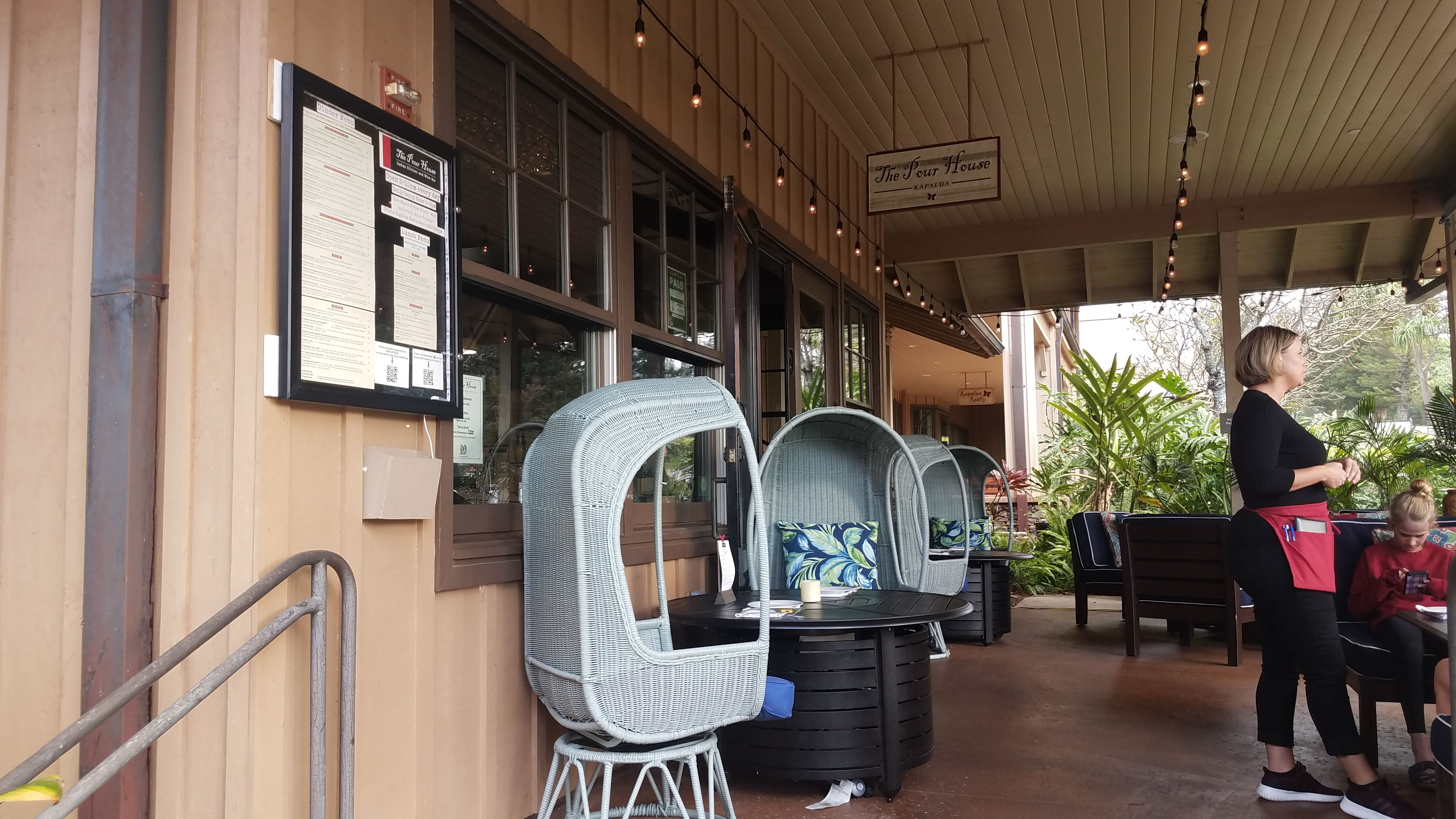 outdoor lanai seating at the pour house kapalua maui