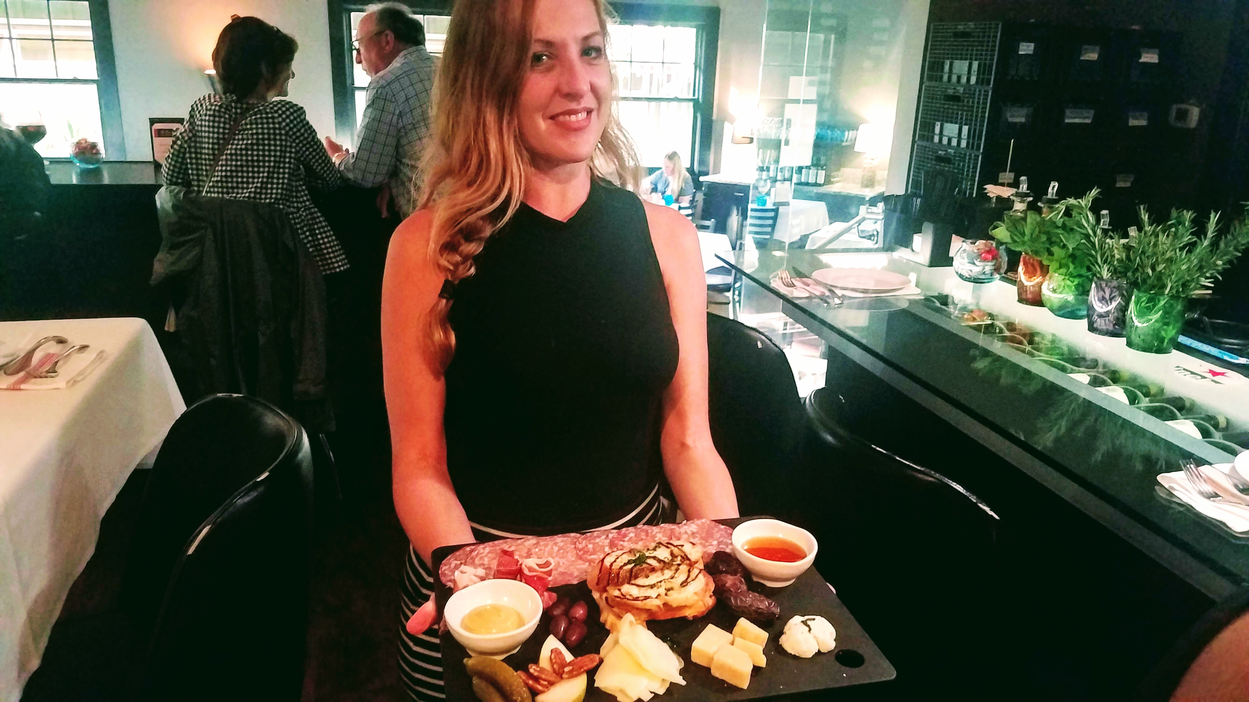 sk laverty with charcuterie cheese tray at pour house kapalua maui hawaii