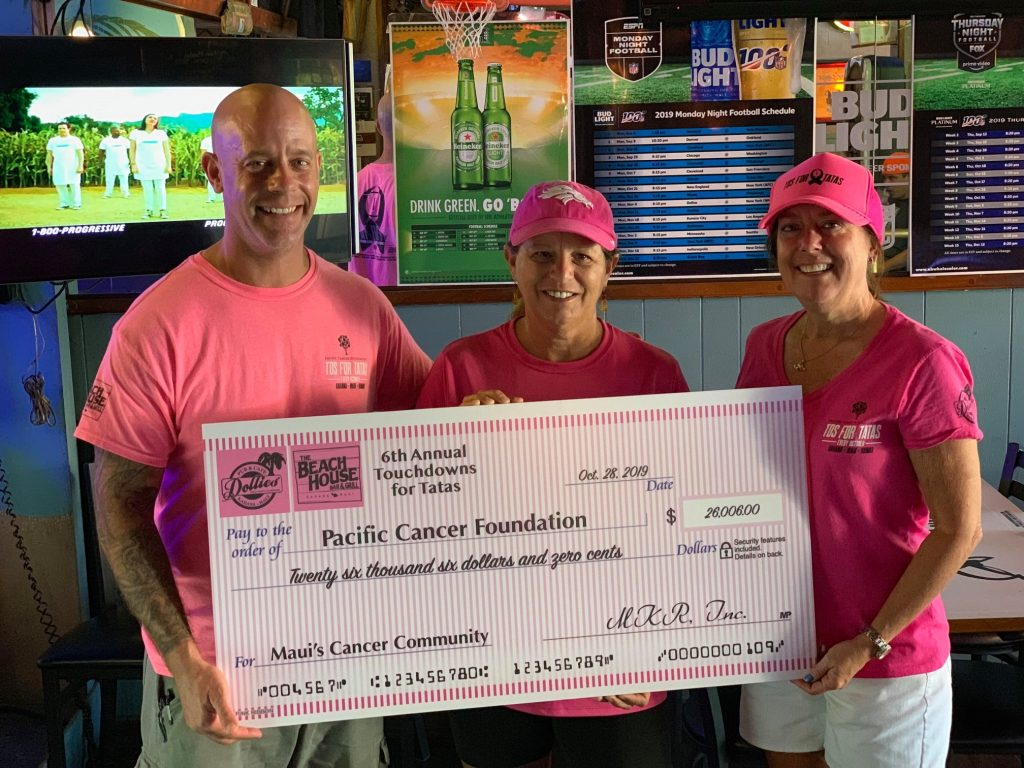 dollies of maui huge check donation to pacific cancer foundation