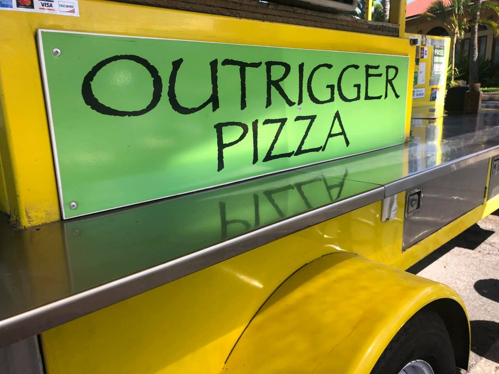 What is the happy hour at Outrigger Pizza Maui