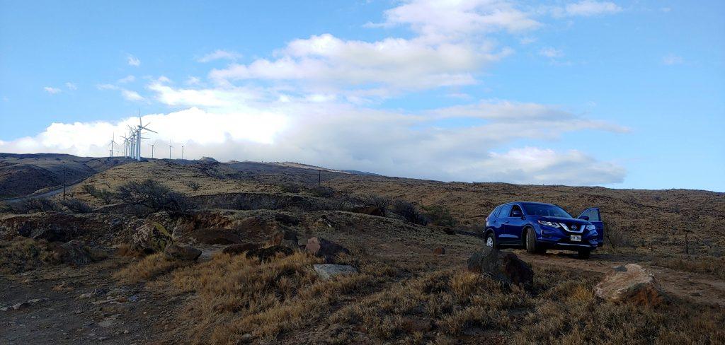 Blue Nissan Rogue SUV and Windmills Maui HI