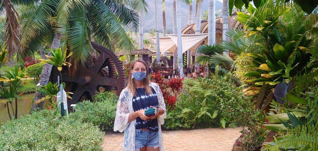 Kayla Delong Maui Hawaii at Cafe O Lei at The Mill House - Wearing a Mask in Front of the Waterwheel at Maui Tropical Plantation