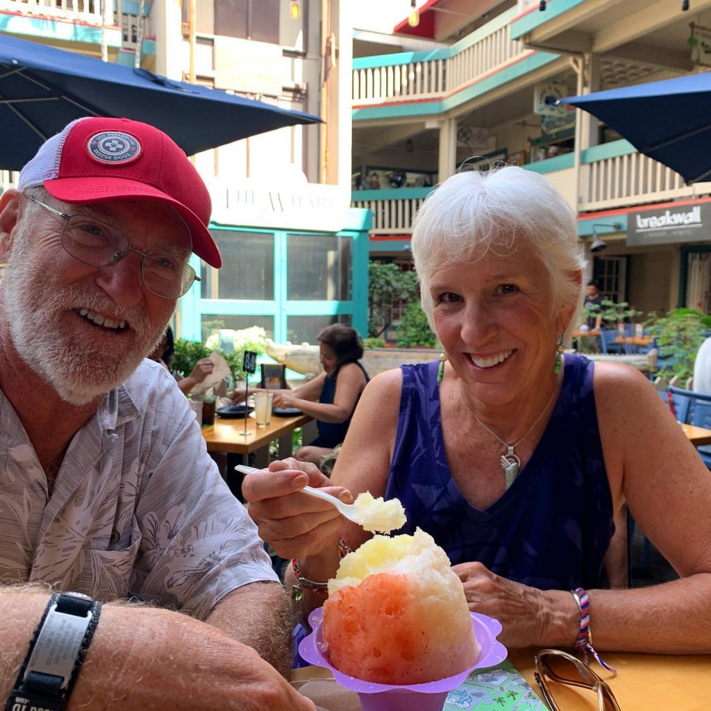 maui couple doing happy hour at breakwall shave ice in lahaina hawaii