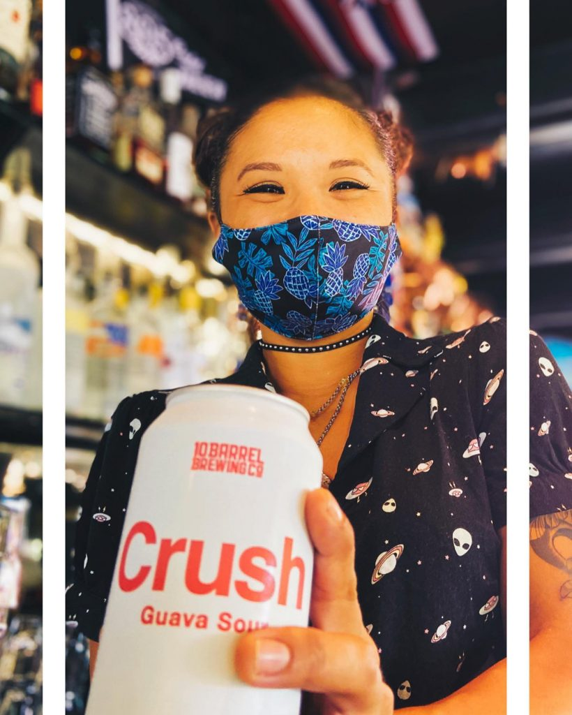 Maui bartender with mask and 10 Barrel Brewing Co Can of Crush Guava Sour