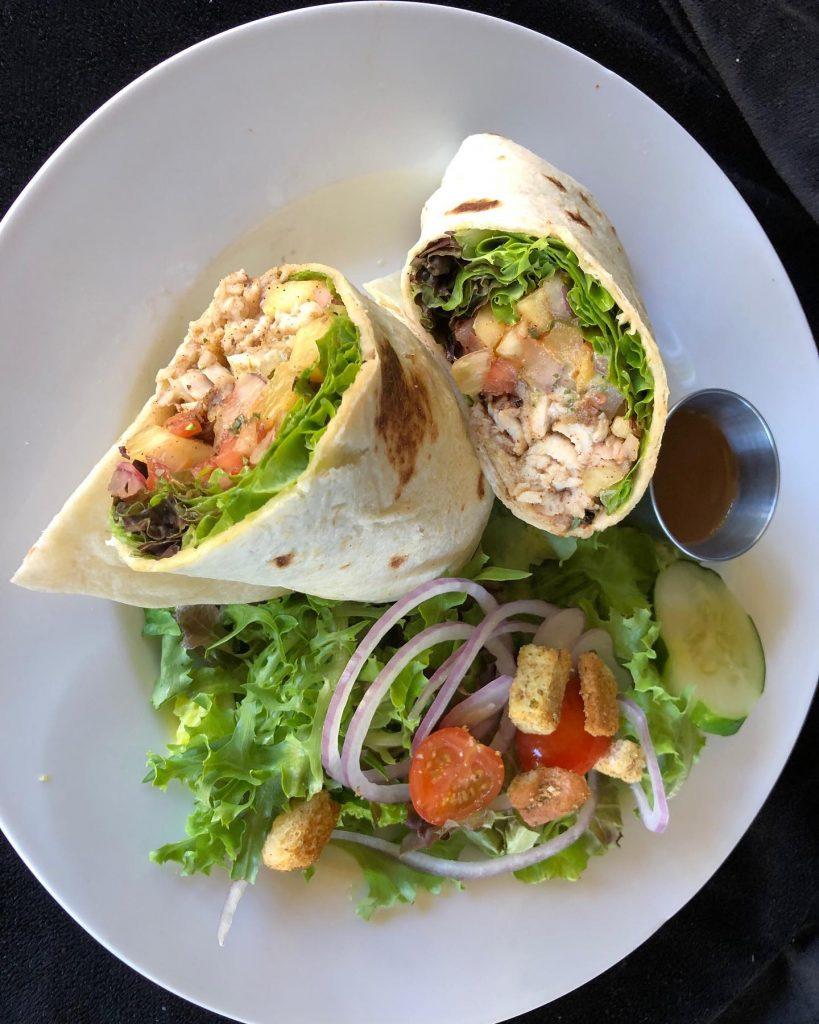 Jerk Chicken Wrap with Side Salad at Captain Jacks Maui Restaurant