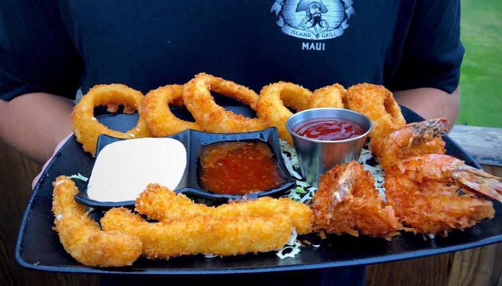 Happy hour appetizer sampler - onion rings, fish sticks, coconut shrimp