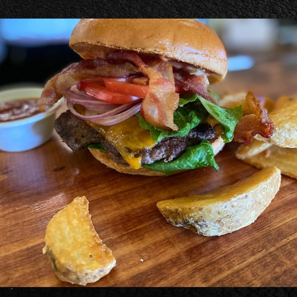 Happy hour bacon cheeseburger with potato wedges