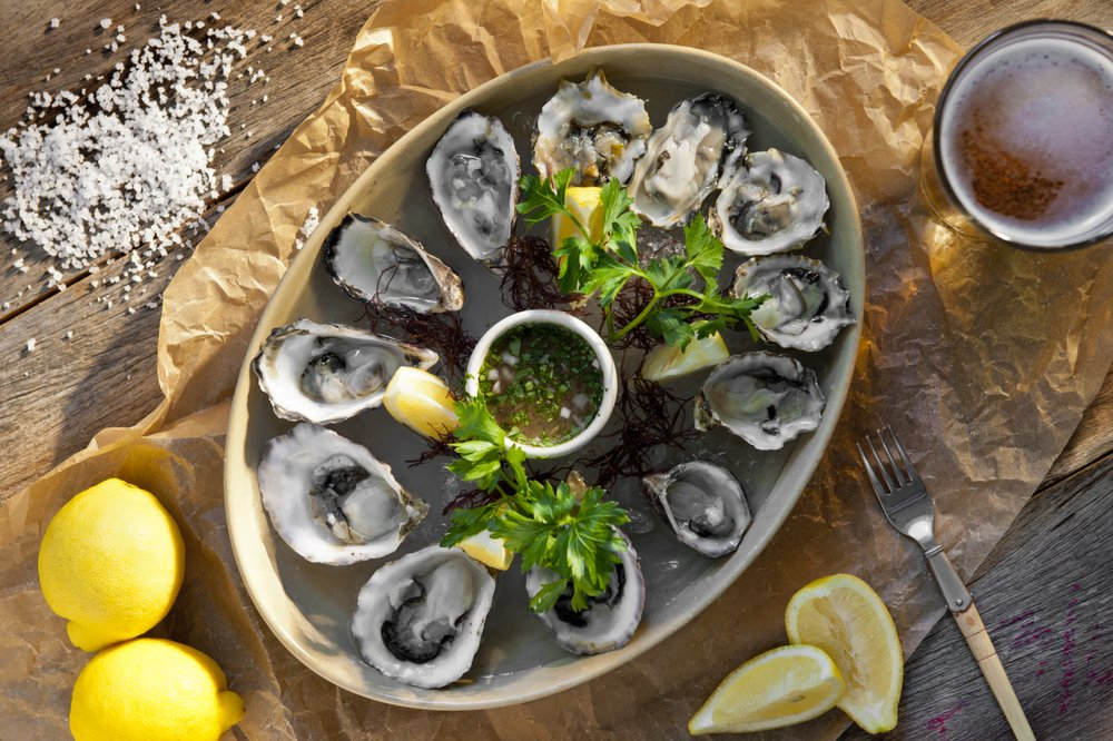 Happy Hour at Honu - Oysters on the Half Shell with Lemon and Cilantro paired with craft Beer