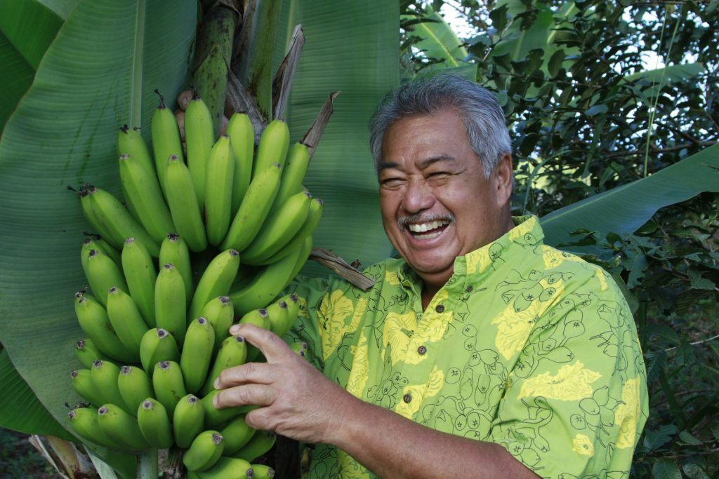 Smiling Man with Wild Bananas