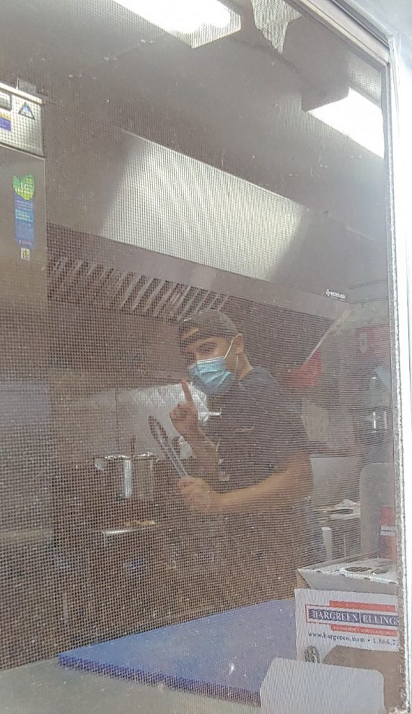 Kyle owner of Maui Taco Loco food truck - food truck chef with mask on