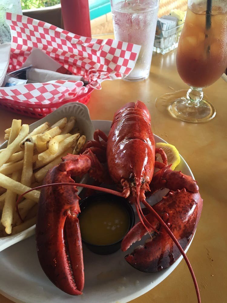 Whole Maine Lobster with French Fries and a Mai Tai Cocktail