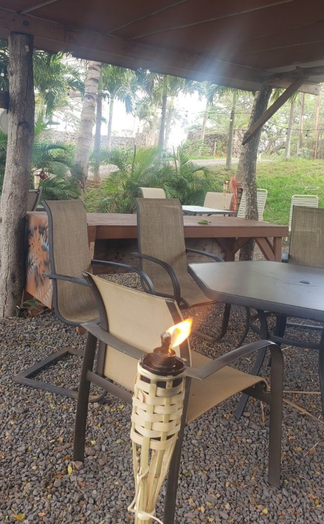 Tiki torch and outdoor seating at Maui Taco Loco food truck