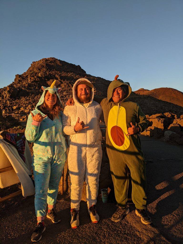 Kayla Russell and Sal from Maui Happy Hours wearing onesies at Haleakala sunrise