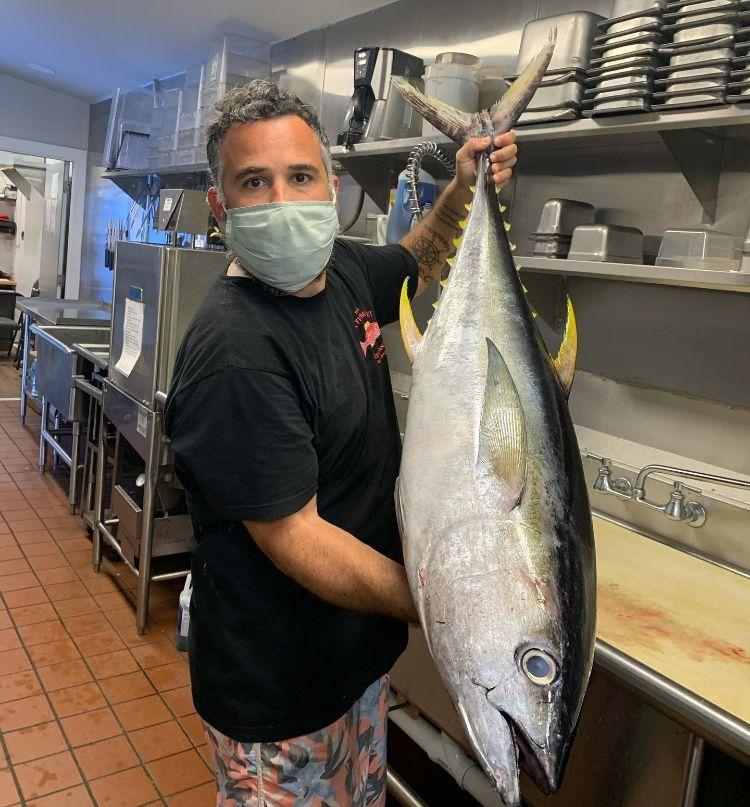 Huge fish - fresh ahi tuna - chef with mask