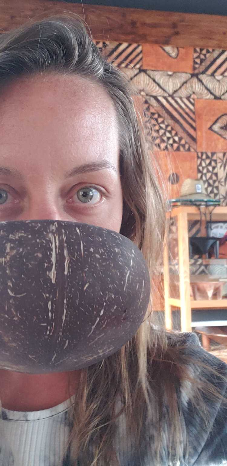 Kayla drinking kava with intense blue eyes