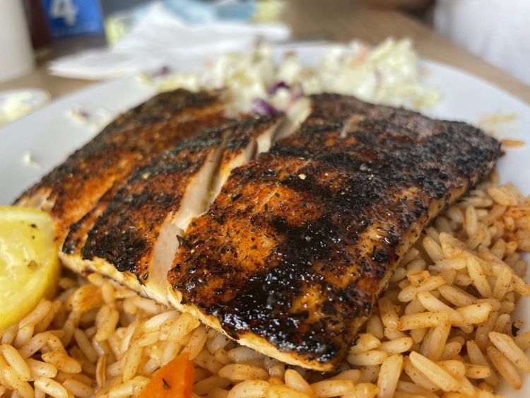 Grilled fish on rice at Paia Fish Market restaurant