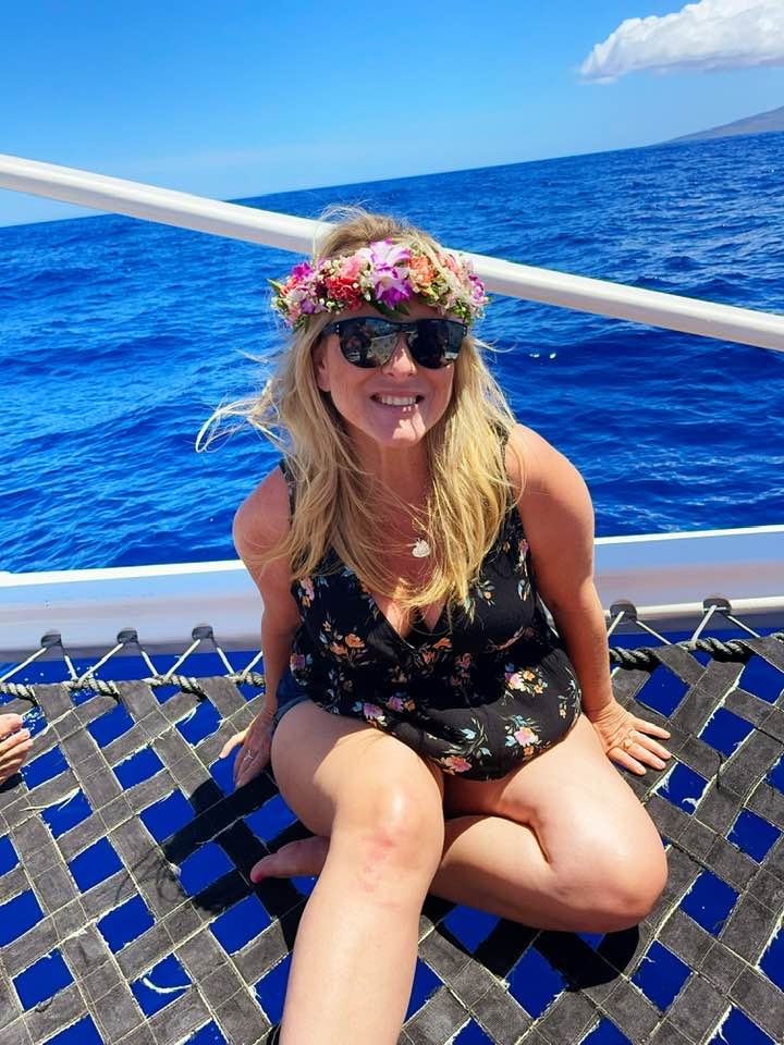 Rebecca Wells Maui Hawaii on a boat to watch dolphins