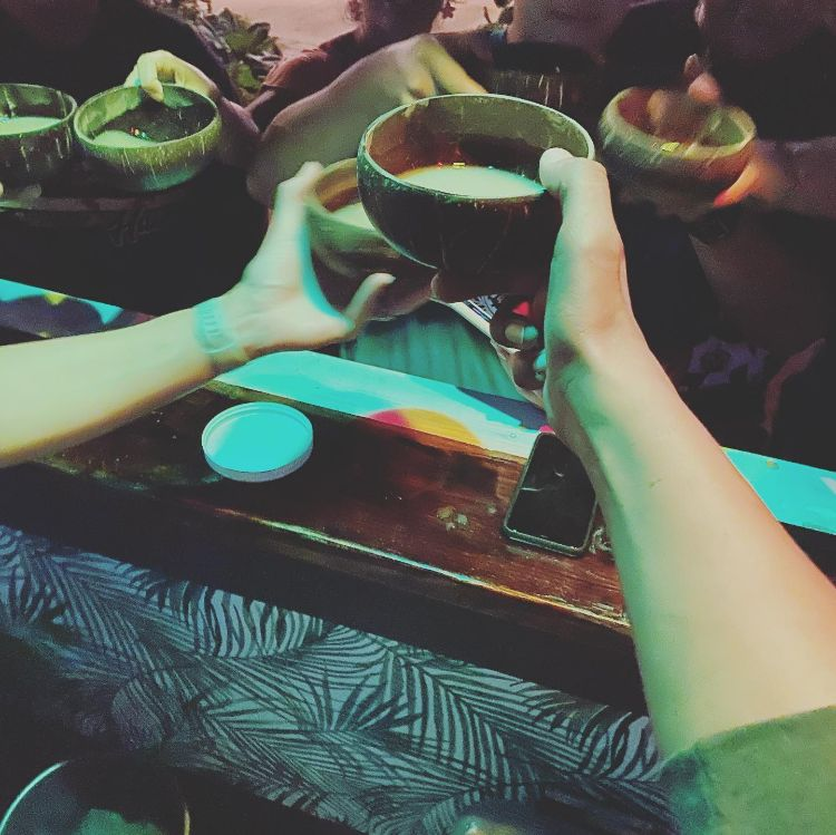 Toasting with kava bowls