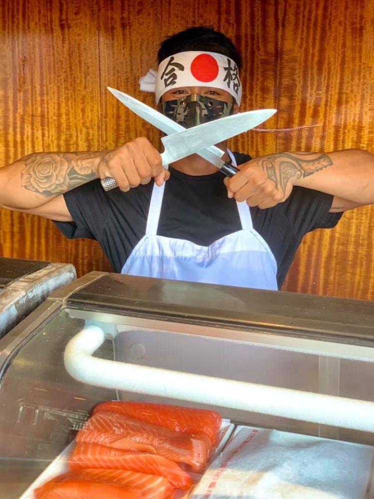 Hawaiian sushi chef with knives at happy hour