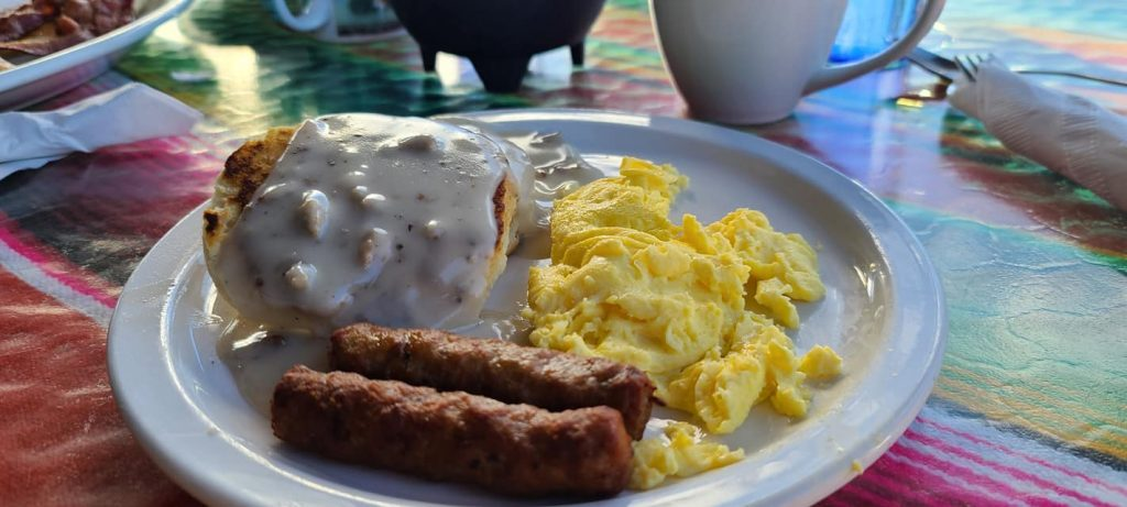 Biscuits and gravy with eggs and sausage