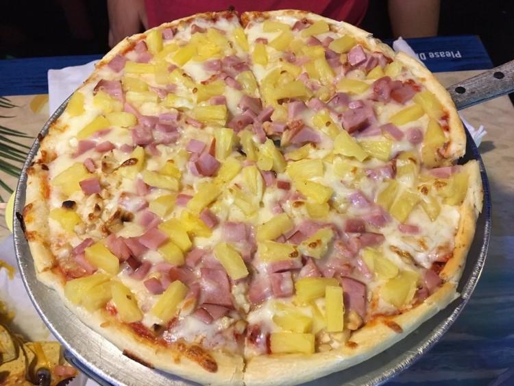 Happy Hour Hawaiian Pizza with pineapple and ham