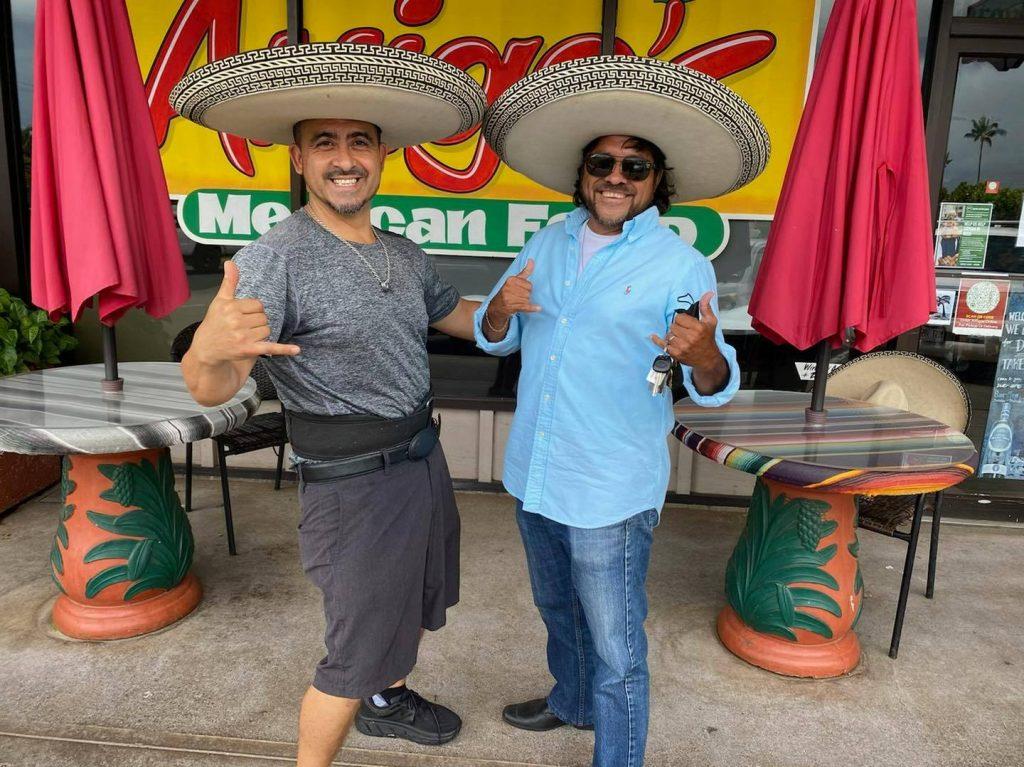 Jesus Ortega Mexican restaurant owner in sombrero with amigo