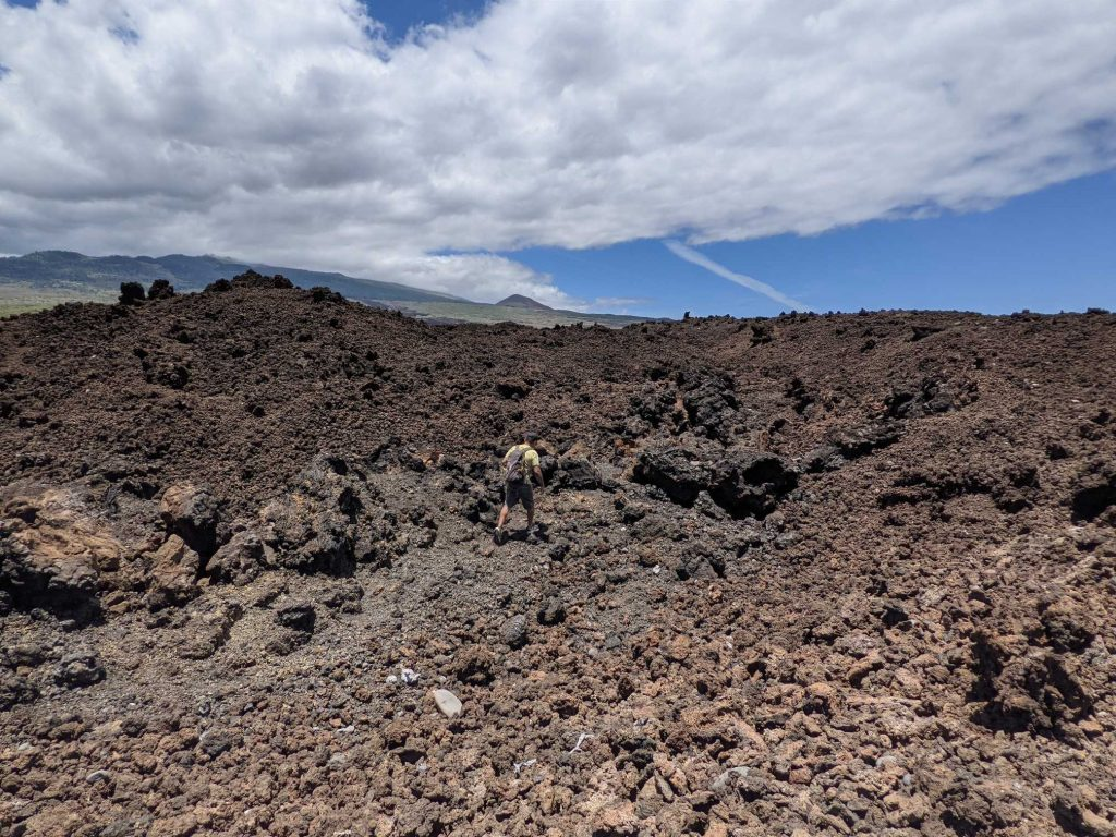 Sal Sanchez hiking lava fields in Hawaii
