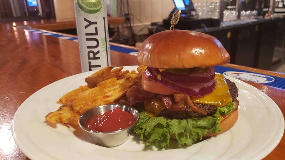 Happy hour bacon cheeseburger with truly lime