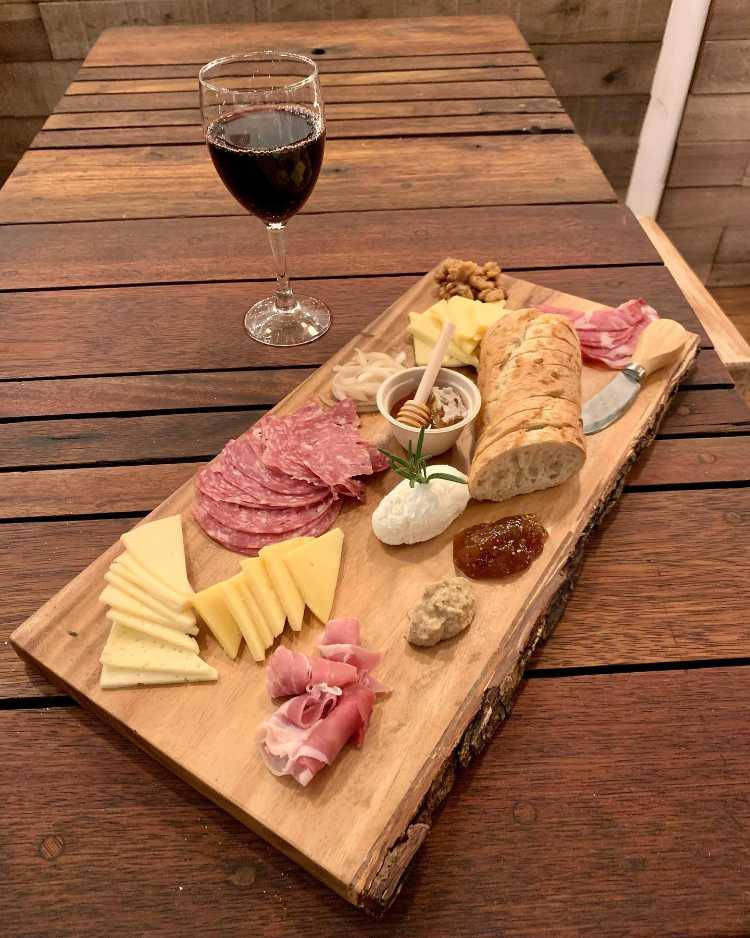 Charcuterie board with wine at Maui happy hour