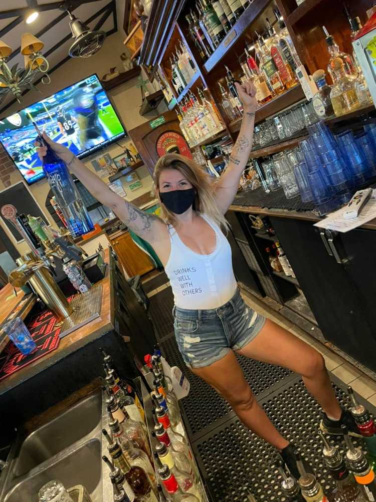 Hot bartender with mask at Maui irish pub