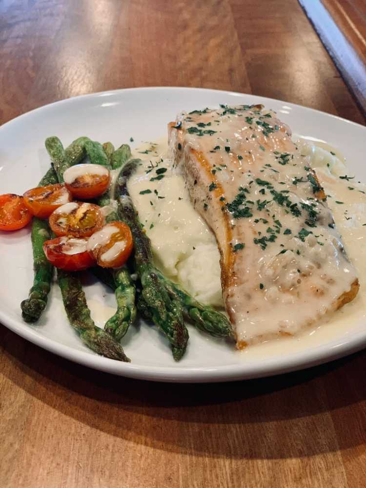 Fish and asparagus with mashed potatoes and cherry tomatos